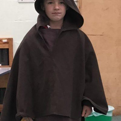 Oskar dressed as farmer